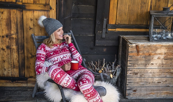Woman in Christmas PJs drinking cocoa