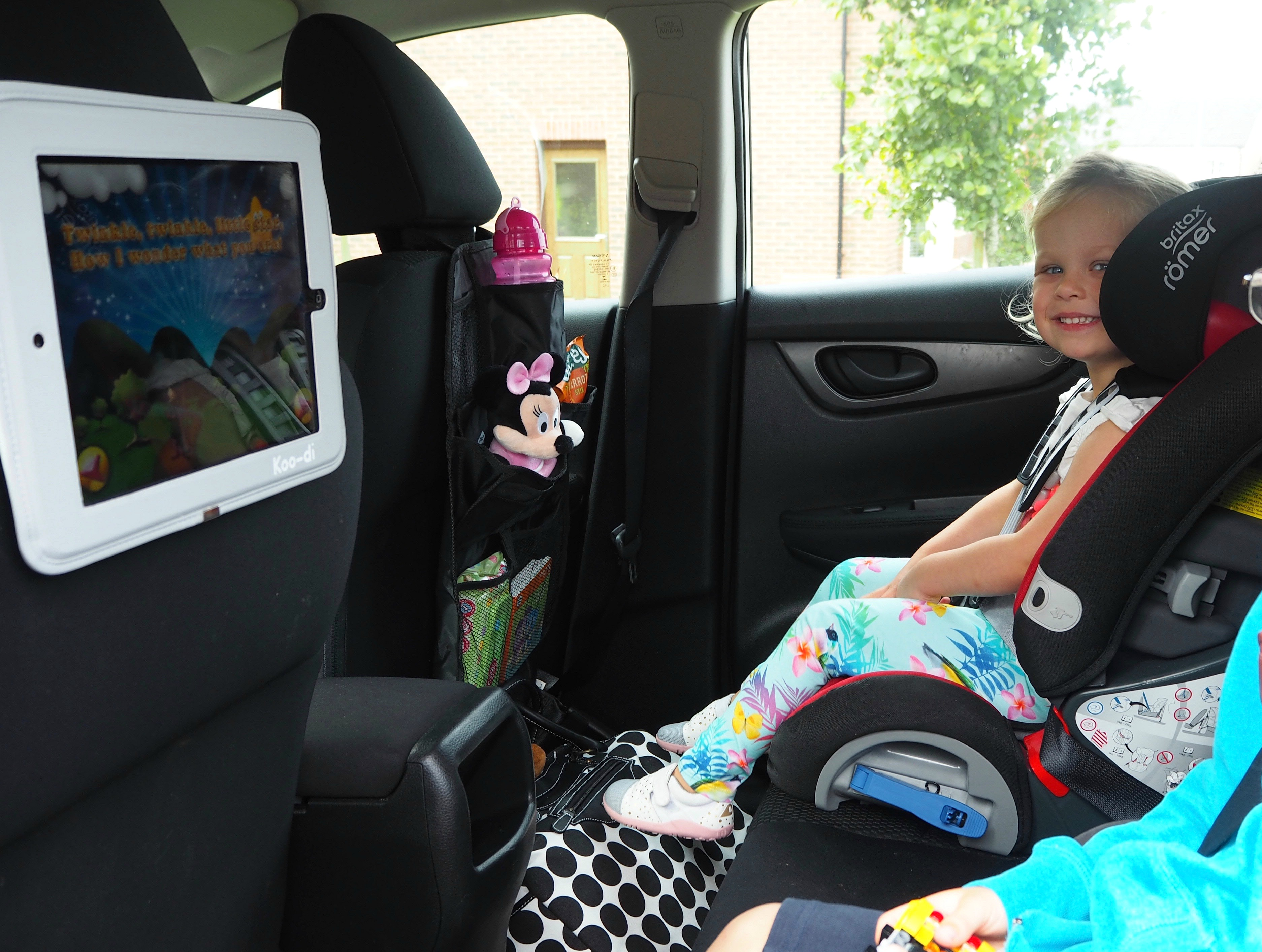 Travelling children with ipad