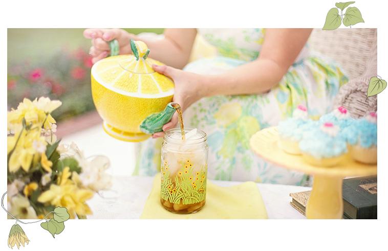 Woman pouring tea, lemon teapot, cupcakes