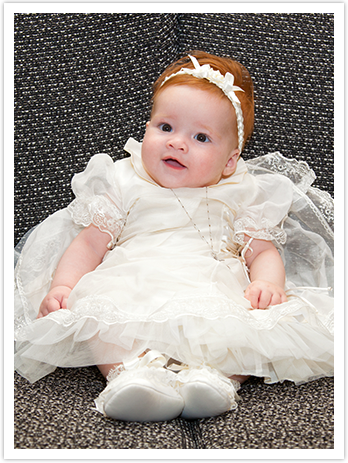Baby girl in christening dress